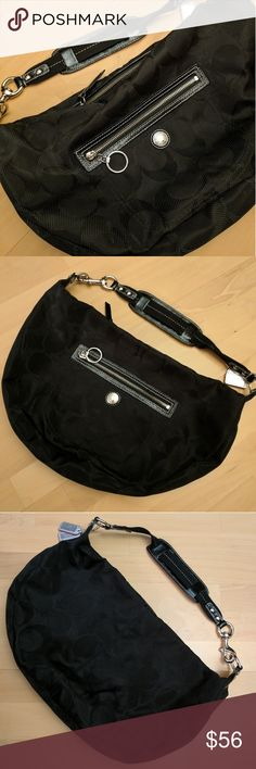 """Black Coach Hobo Shoulder Bag!! Like New, Mint Condition Black Monogram Authentic Coach Hobo Shoulder Bag!! Black material with black monogram design. Silver zipper decor. Small front zipper pocket. Size 17"""" x 12"""" x 3"""". Shoulder strap with buckle design. Mint condition. A few small pen marks inside, otherwise great condition bag! Coach Bags"""