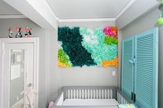 The DIY tissue paper backdrop in Lorelle's Lovingly Handmade Nursery adds color and texture to the wall.