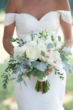 Loving this gorgeous White Ranunculus and Eucalyptus Bouquet. www.belltowerfortworth.com #belltowerchapelandgarden #belltowergarden #weddingplanning #belltowerchapel #belltowerftw #chapelftw #weddingflowers #beautifulwedding #weddingdetails #bride