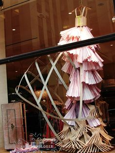 gorgeous + creative window display with wooden hangers. Anthropologie