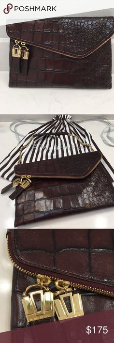 """HENRI BENDEL LEATHER CLUTCH with chain. Very nice condition, used maybe twice, stored with stuffing, in dust bag (included), no pets.  Use as shorter shoulder bag with chain OR tuck chain in and use as adorable clutch. **Bag color is a rich port wine, burgundy color with brownish undertones (there is no """"port wine"""" color option available and closest color choice was """"brown""""). henri bendel Bags Clutches & Wristlets"""