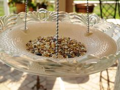recycled ceiling light fixture makes a great bird feeder and easy to make as the holes are already in the light shade.