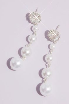 The classic pairing of crystal and pearl never goes out of style, particularly when arranged like this sophisticated pair. By Natasha Glass, crystal, resin, brass Imported Pearl Earrings Wedding, Bride Earrings, Crystal Resin, Glass Crystal, Beige Bridesmaids, Pageant Earrings, Chandelier Earrings, Drop Earrings, Bride Accessories