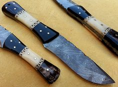 Damascus Skinner knife SK-21  Open Length: 8.5 Inches Blade Length: 4 Inches Handle Length: 4.5 Inches Price: $70USD Made of Camel bone, Bull horn,