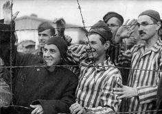 Jubilant Dachau survivors greet their US Army liberators.