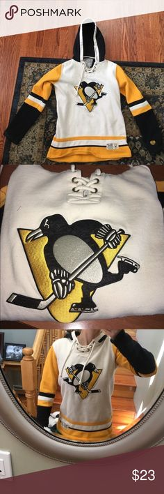Pittsburgh Penguins sweatshirt! 🎉 Awesome sweatshirt sold for a great price! There is definitely some wear to it, there a few small permanent stains as pictured. But otherwise, great condition and super cute on! Tops Sweatshirts & Hoodies