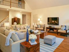 Family room with great color scheme...love the off-white walls with white trim/ceiling and blue accents.