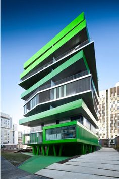 Villiot-Rapee Apartments - Exterior/Entrance: Vibrant green colors emphasize the stacked floors that allows the fresh air to the buildings.