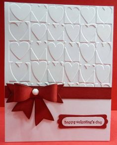 handmade Valentine ... clean and elegant look ... luv the paper bow ... heart embossing folder texture ... lovely ...