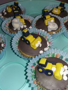 Baby shower cupcakes with a yellow digger theme for baby boy. close up. tplh