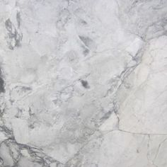 WHITE VERMONT EXTRA. Chunky soft white background with faint grey veining. Beautiful marble color available at Knoxville's Stone Interiors. Showroom located at 3900 Middlebrook Pike, Knoxville, TN. www.knoxstoneinteriors.com. FREE Estimates available, call 865-971-5800