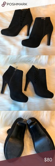 Lane Bryant faux suede black ankle boots w/ heel EUC Lane Bryant faux suede black ankle boots w/ heel and zipper. Gorgeous! Size 9W. See pics for heel measurements, width across when zipped is approx 3.5-4 in. across. I can send a pic if it's helpful. The open detail gives it some stretch. These are perfect on trend ankle boots with a perfect and sexy heel!!!!  Lane Bryant Shoes Ankle Boots & Booties