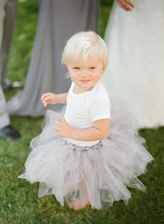 Tutus for baby flower girls | More on Style Me Pretty: http://www.StyleMePretty.com/2014/02/12/diy-greenwood-hills-country-club-wedding/ The McCartneys Photography