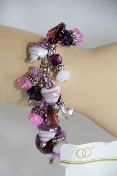 MAUVE, PINK & WHITE GLASS BEAD CHARM BRACELET ONLY $20.00, dont forget our Easter Special enter code 20369741 to recieve 20% off EVERYTHING in store, until 2nd April 2013.