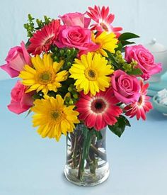 A smaller bouquet that includes a vase would be a great gift that the recipient can enjoy after the flowers have finished. The flowers are colourful.