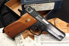 Smith & Wesson Model 39-2, 9mm pistol. Mrs. Smith I am better with her than siggy