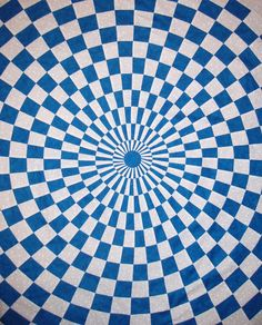 Close up, optical illusion quilt pattern in blue and white by Erin Underwood Quilts