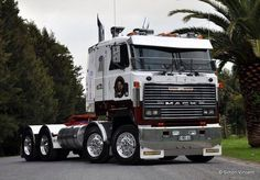 Mack from Australia ??????????????? I have not seen one of these MACK Diesel Cars with two steering tires. Wild!!!