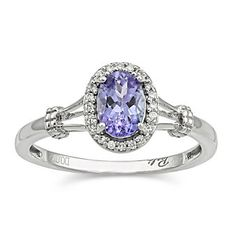 14k White Gold Oval Tanzanite and Diamond Ring, I love unique rings and I'd be perfectly happy with a gemstone wedding ring :)