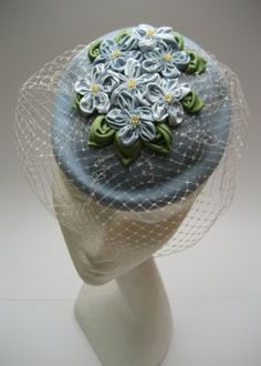 Beret style percher hat with 'forget me not' flowers