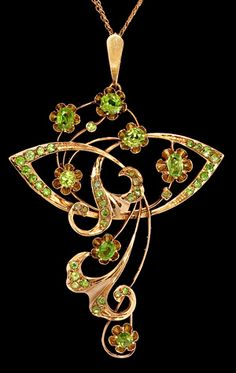"An Art Nouveau Antique Russian Floral Pendant    made in Moscow between 1908 and 1917.    56 zolotniks polished rose gold (14K - 583), over 2 carats of Russian  demantoid garnets from the Ural Mountains with  typical ""horsetail"" inclusions."