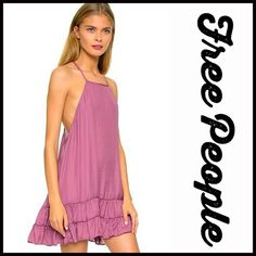 """SOLD FREE PEOPLE Slip Dress RETAIL PRICE: $88 NEW WITH TAGS   FREE PEOPLE Trapeze Slip Dress  * Halter neck front, thin straps & tiered ruffle hem  * A-line, subtle semi pleated trapeze silhouette; Semi backless ,open back detail  * Pullover style & a relaxed fit   * It measures about 33"""" long  * Lightweight Fabric: 100% Polyester Color: Rose Item: # Pastel Fuschia Item:94900 No Trades ✅ Offers Considered*/Bundle Discounts✅  *Please use the blue 'offer' button to submit an offer. Free People…"""
