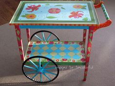 Such a cute painted tea cart...wondering if the woman at B Cheeky in Boxford would paint mine if I decide to?