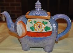Elephant Teapot - Blue Luster Glaze. One like this from my Grandma. Her mother gave her and two sisters each one before 1947.
