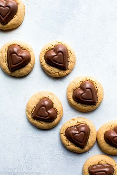 Soft peanut butter cookies with Valentine's Day heart candies! Recipe on sallysbakingaddiction.com