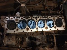 Cylinder head removed, before any cleaning or buffing.  Decades of old rusty coolant ports evident.