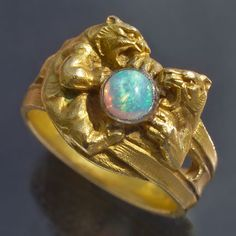 BELLE EPOQUE  Lioness Ring   Gold Opal     Marks: Eagle's head & indistinct maker's mark  French, c.1900  Ring Case  French Jewellery 1850-1910