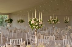 silver candelabras decorated with a sphere of roses and summer flowers.