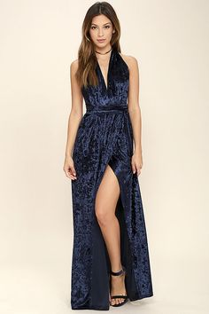 Once the Aphrodite's Kiss Navy Blue Velvet Halter Maxi Dress comes along, love and romance will follow! Luxurious crushed velvet falls from an elasticized halter neckline, into a wrapping bodice that carries into a cascading maxi skirt. Open back and tying sash belt.