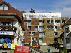 Apartm�ny Centrum Harrachov Apartm?ny Centrum is a self-catering accommodation located in the centre of Harrachov, 50 metres from a children ski lift, and 100 metres from the ?ertova Hora Ski Lift and cable car. Ski storage and ski equipment hire are offered.