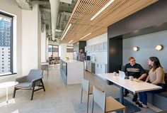 BCCI was selected to build out the square-foot interiors space, which mirrors the look and feel of Forbes' New Jersey headquarters – an open concept design with a similar furniture and color scheme. Micro Kitchen, Commercial Office Space, Open Ceiling, Wood Ceilings, Wood Accents, Open Concept, Dining, Architecture, Table