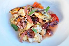 La Tavola's GRILLED CALAMARI garlic-roasted cauliflower, Gaeta olives, cherry tomatoes, pickled red onion    http://latavolatrattoria.com