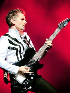 I think Matt Bellamy is channeling Michael Jackson.  But he rocks the space suits like no one could ever pull off.