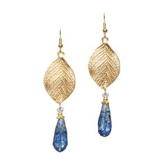 $22.00 Earthy with an edge, the Millie Earrings look equally great with jeans or a tan or ivory suit. The veined gold leaf is the perfect topper for the CZ bead and faceted blue topaz droplet.