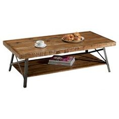 """Artfully crafted of reclaimed wood and metal, this rustic coffee table showcases a planked top and open bottom shelf. Product: Coffee tableConstruction Material: Reclaimed wood and metalColor: Natural and blackFeatures: Open shelfDimensions: 18"""" H x 48"""" W x 24"""" D"""