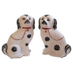 "Famous collectible porcelain dogs from Jay Willfred Andrea by Sadek, hand-painted in Portugal. No two sets are alike. Each dog is numbered and initialed. Dimensions: 8""W × 4.5""D × 11""H Condition: Exce"