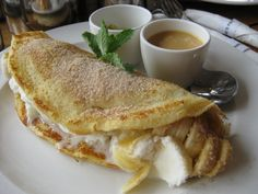 Pancake filled with banana and vanilla ice cream served with caramel sauce on the side. South African Desserts, South African Dishes, South African Recipes, Pancake Fillings, Hot Desserts, Winter Treats, Specialty Foods, Pancakes, Foods To Eat