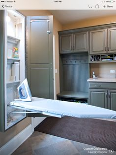 Mud room built in ironing board cabinet
