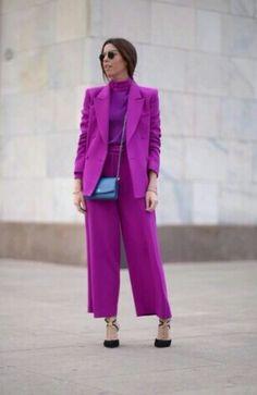 purple suit + purple shirt + navy purse + black heels