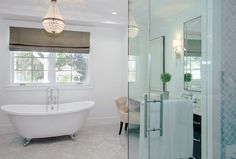 Marc Anthony's California home's gorgeous bathroom with chandelier over bathtub