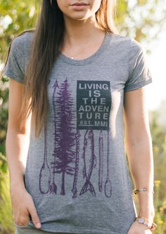 """""""Living Is The Adventure"""" - Each shirt purchased donates $7 to First Descents to support cancer fighters and survivors."""