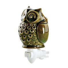 """OWL NIGHT LIGHT  Whooo's afraid of the dark? Not our charming little owl. With a pierced body, it adds a bit of light and fragrance to a powder room, bedroom, kitchen or any room in your home where dark corners threaten. Plug the unit directly into a wall outlet and with a flip of the switch begin filling the room with fragrance. The night light/warmer uses our signature scented fragrance gel in your choice of scents. Made of ceramic. On/off switch. 3 x 5½""""  Item: 01179  $10.00"""