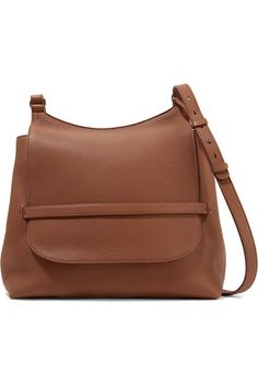 Brown textured-leather  Tab fastening-front flap Designer color: Saddle Comes with dust bag Weighs approximately 2.2lbs/ 1kg
