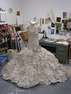 Carrie Ann Schumacher makes these amazing dresses out of pages from romance novels. This one is called Alice and the Boy She Left Behind. www.carrieannschumacher.com