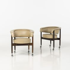 Sergio Rodrigues; Rosewood, Leather and Chromed Metal 'BEG' Chairs, 1950s.