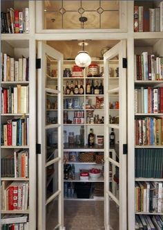 Better Homes and Gardens - Pantry with a bookcase for cookbooks.  Love it! Want it! Need it desperately.